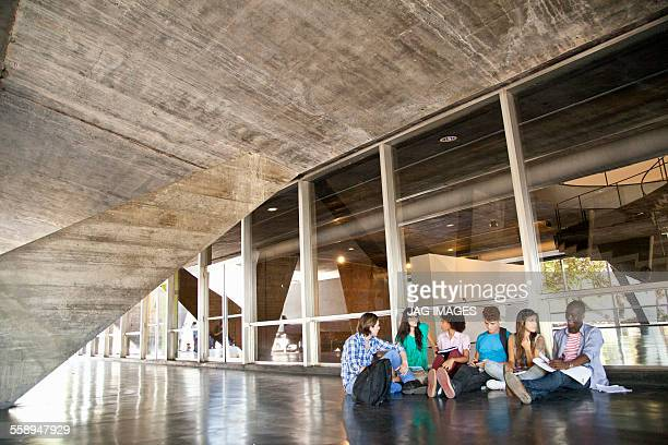 Higher education students sitting on floor