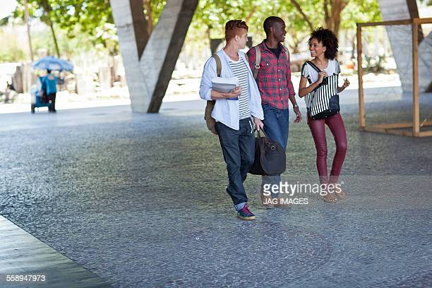 Higher education students walking on campus
