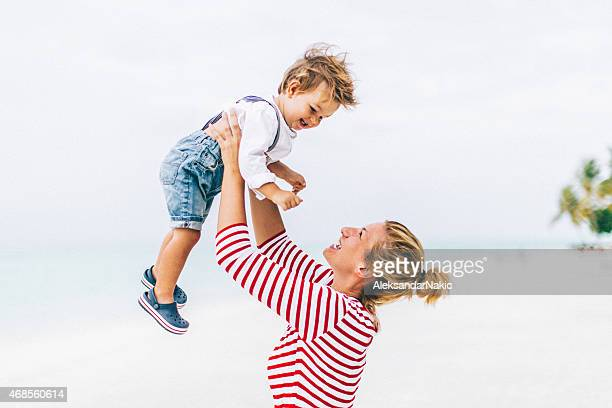 higher mommy! - mothers day beach stock pictures, royalty-free photos & images
