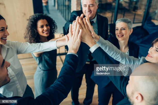 high-five for success! - staff meeting stock pictures, royalty-free photos & images