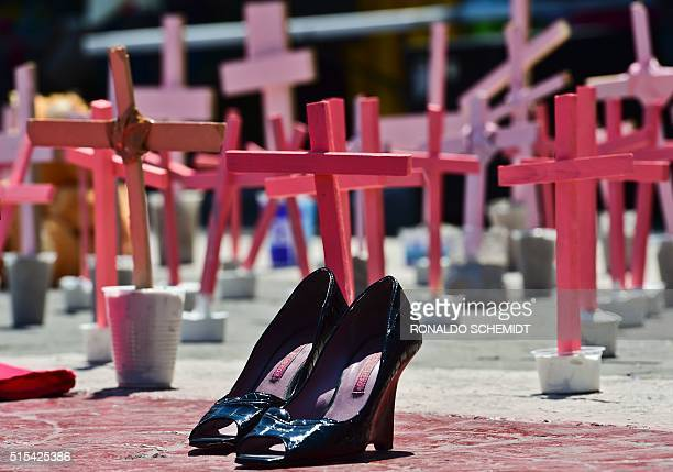 Highheeled shoes from a victim of femicide are pictured next to crosses during a protest against the murder of more than 600 women in the last four...