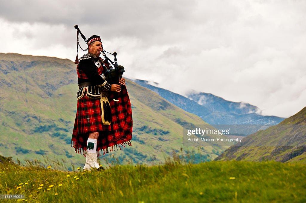 Highland bagpiper in kilt : Stock Photo