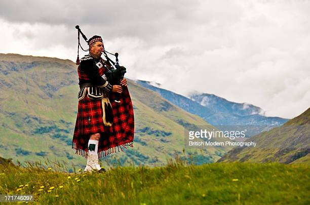 highland bagpiper in kilt - kilt stock photos and pictures
