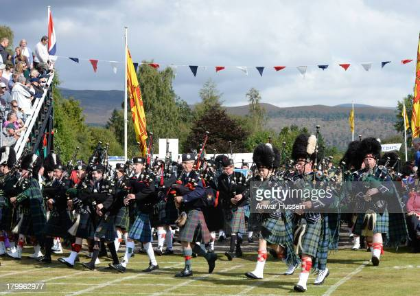 Highland bands participate in the Braemar Highland Games at The Princess Royal and Duke of Fife Memorial Park on September 7 2013 in Braemar Scotland
