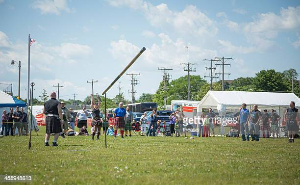 highland games - caber toss - theasis stock pictures, royalty-free photos & images