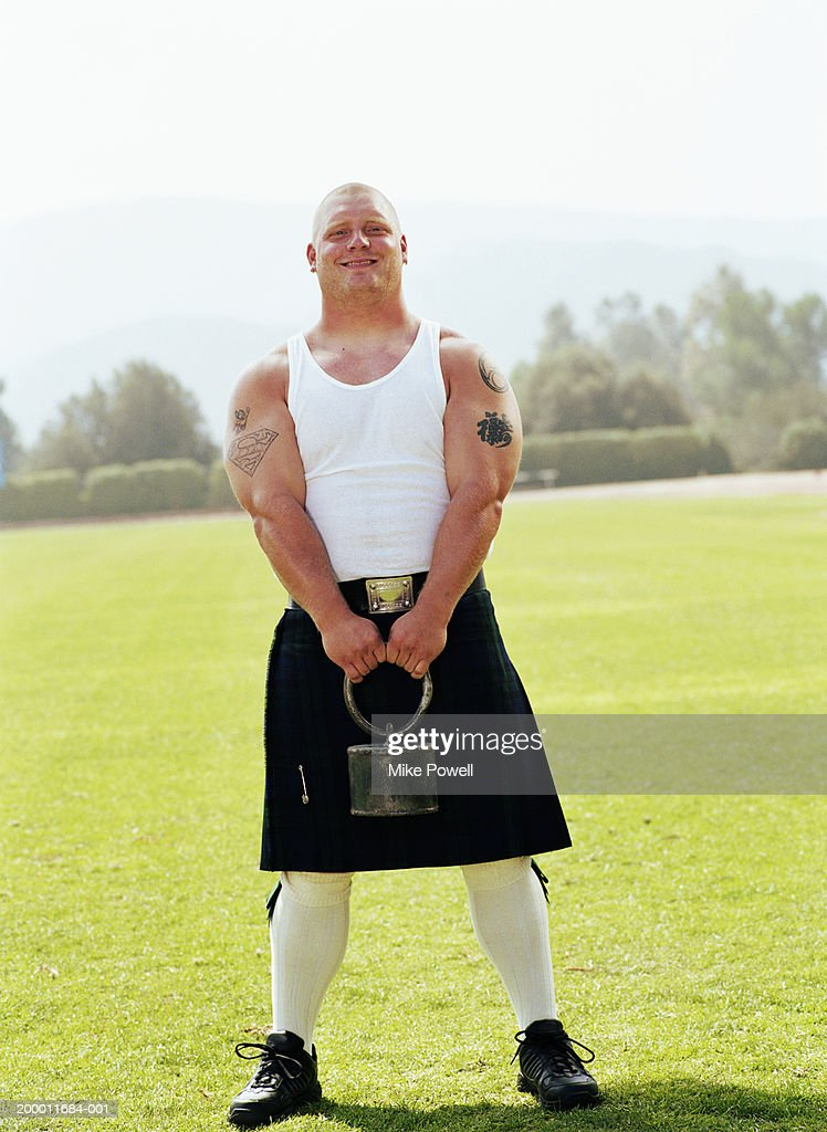 Highland Games, competitor holding throwing weight : Stock Photo