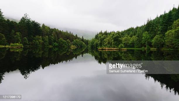 highland lake view - symmetry stock pictures, royalty-free photos & images