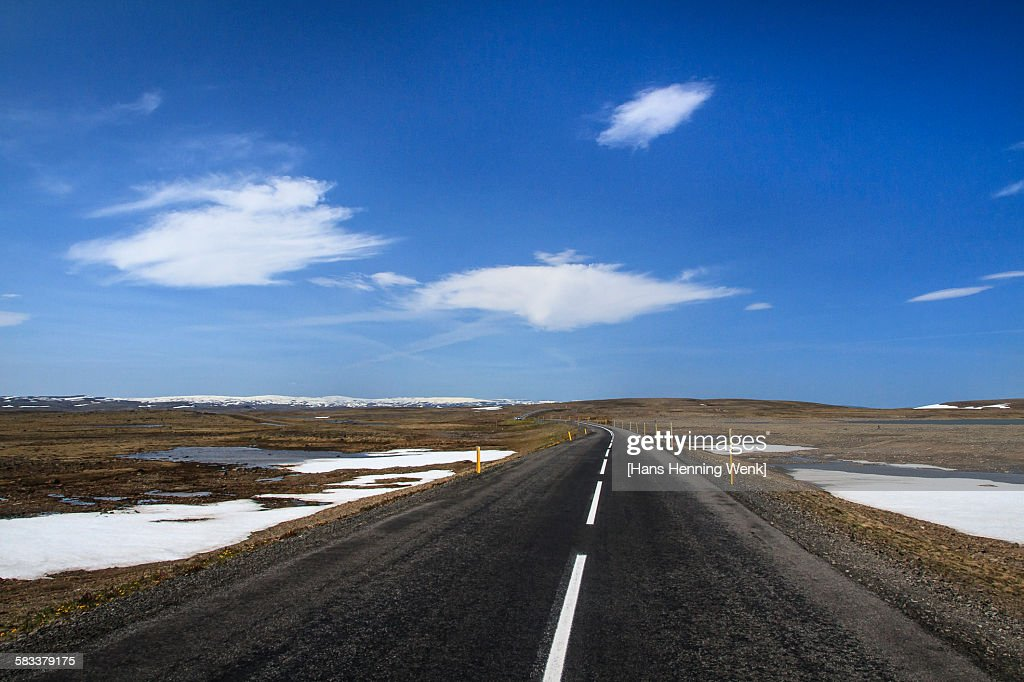 Highland road with blue sky : Stock Photo