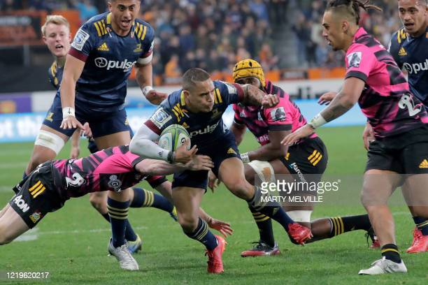 Highlanders' Aaron Smith is tackled during the Super Rugby match between the Otago Highlanders and Waikato Chiefs at Forsyth Barr Stadium in Dunedin...