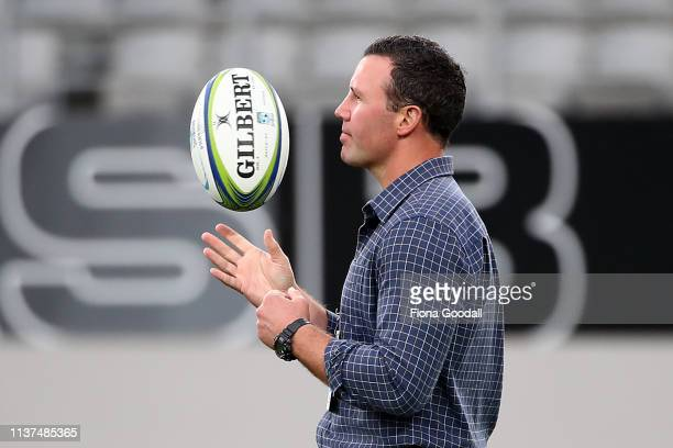 Highlanders coach Aaron Mauger watches the team warm up during the round six Super Rugby match between the Blues and the Highlanders at Eden Park on...