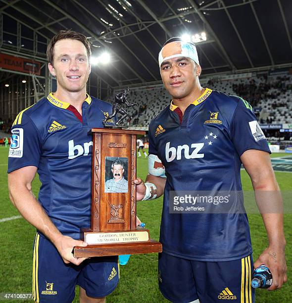 Highlanders cocaptains Ben Smith and Nasi Manu pose for a photo after the Highlanders win during the round two Super Rugby match between the...