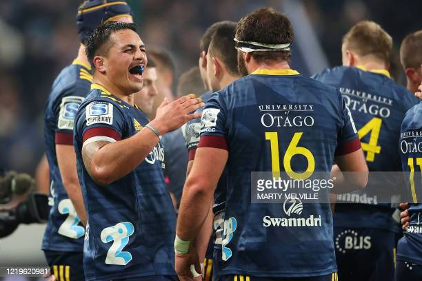 Highlanders' Daniel Lienert-Brown celebrates victory with teammate Liam Coltman during the Super Rugby match between the Otago Highlanders and...