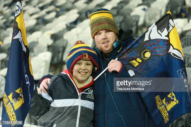 Highlanders fans pose for photos during the round 4 Super Rugby Aotearoa match between the Highlanders and the Crusaders at Forsyth Barr Stadium on...