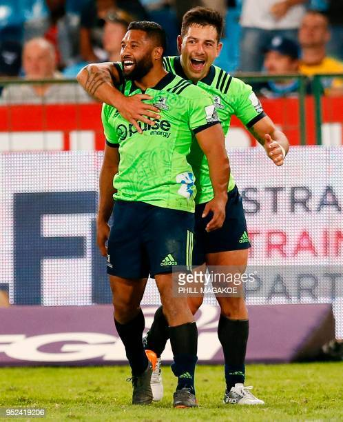 Highlanders' flyhalf Lima Sopoaga and New Zealand lock Rob Thompson celebrate after winning the SUPERXV Rugby match between Bulls and Highlanders at...
