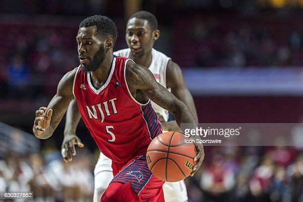 Highlanders guard Damon Lynn brings the ball into play during the game between the NJIT Highlanders and the Temple Owls on December 17 2016 at the...