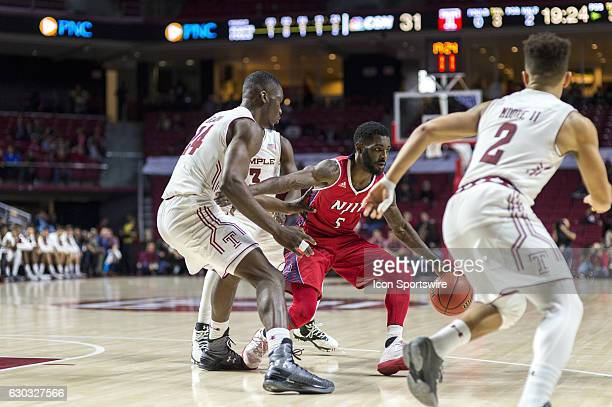 Highlanders guard Damon Lynn looks for a way part his defenders during the game between the NJIT Highlanders and the Temple Owls on December 17 2016...