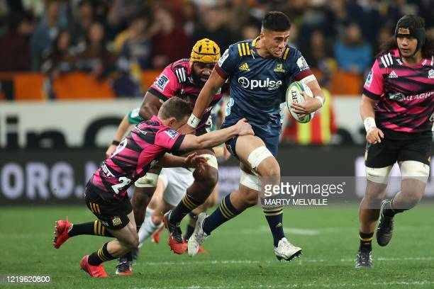 Highlanders' Marino Mikaele Tu'u is tackled by Chiefs' Brad Weber during the Super Rugby match between the Otago Highlanders and Waikato Chiefs at...