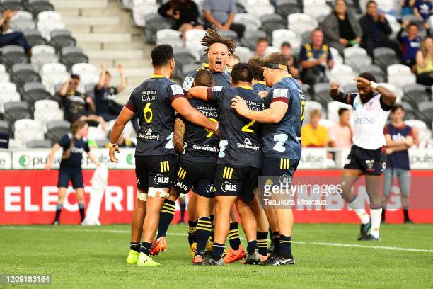 Highlanders players celebrate during the round five Super Rugby match between the Highlanders and the Rebels at Forsyth Barr Stadium on February 28,...