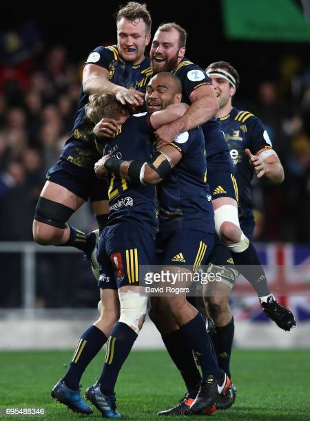 Highlanders players celebrate their team's 2322 victory during the 2017 British Irish Lions tour match between the Highlanders and the British Irish...