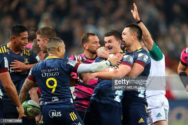 Highlanders' Rob Thompson Bryn Gatland and Aaron Smith celebrate their win during the Super Rugby match between the Otago Highlanders and Waikato...