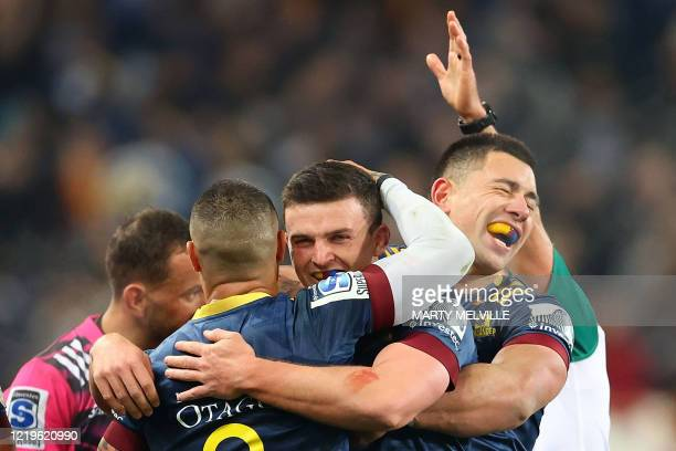 Highlanders' Rob Thompson , Bryn Gatland and Aaron Smith celebrate their win during the Super Rugby match between the Otago Highlanders and Waikato...