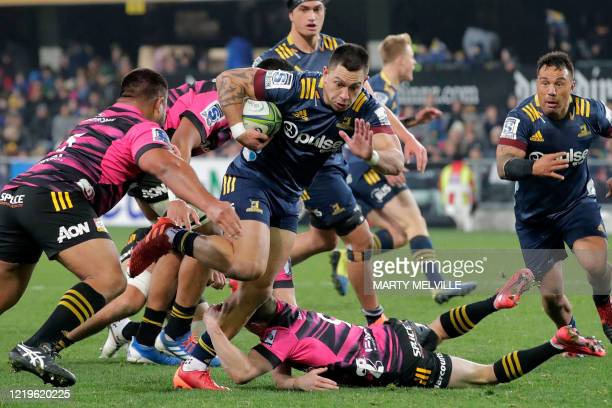 Highlanders' Rob Thompson is tackled during the Super Rugby match between the Otago Highlanders and Waikato Chiefs at Forsyth Barr Stadium in Dunedin...