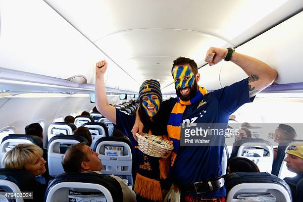 Highlanders supporters Ben and Larissa Jamieson hand out sweets on a plane as they travel to Wellington for the Super Rugby Final match between the...