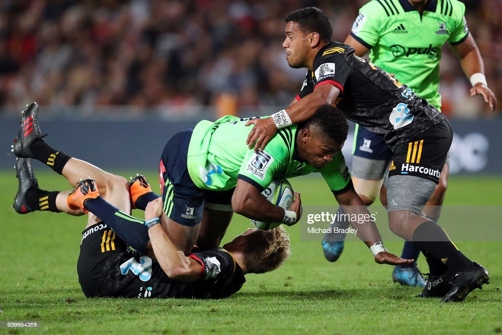 Highlanders Waisake Naholo (C) is tackeld during the round seven Super Rugby match between the Chiefs and the Highlanders at FMG Stadium on March 30, 2018 in Hamilton, New Zealand.