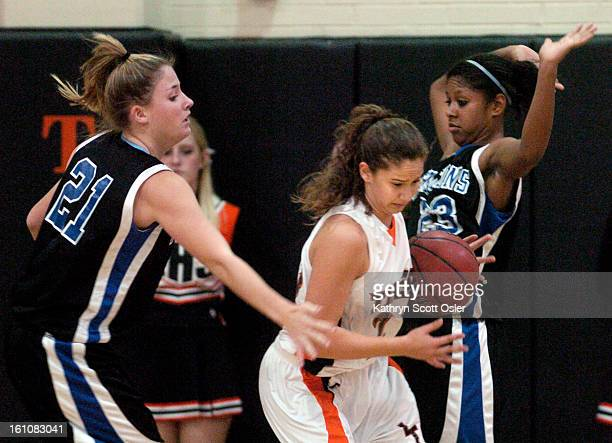Highlands Ranch High School at Lakewood High School girls hoops. Lakewood's Erica Hicks<cq> tries to push past Highland Ranch's Jordan Floyd<cq> and...