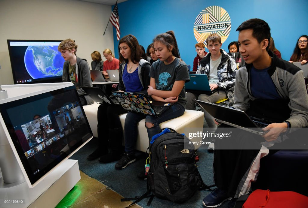 Highlands Ranch high school freshman Jaeden Toy, right, talks with students at Arickaree High School via high-tech video conferencing equipment, which includes a 360 camera February 21, 2018.