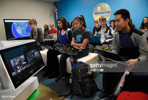 Highlands Ranch high school freshman Jaeden Toy right talks with students at Arickaree High School via hightech video conferencing equipment which...