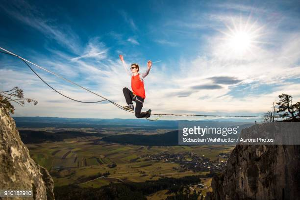 Highline athlete walking on slackline in Austrian Lower Alps, Peilstein, Austria
