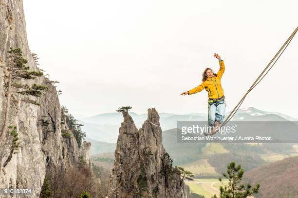 Highline athlete walking on slackline in mountains, Peilstein, Austria
