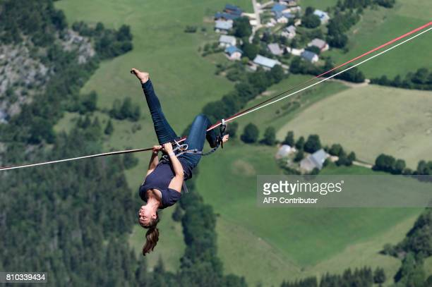 A highliner flips around a slackline during the European 'Marmotte Highline Project' meeting on July 7 2017 in LansenVercors near Grenoble eastern...
