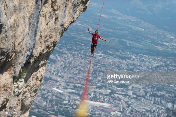 TOPSHOT A highliner walks on a slackline during the European 'Marmotte Highline Project' meeting on July 7 2017 in LansenVercors near Grenoble...