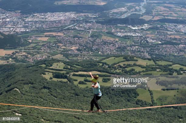 A highliner walks on a slackline during the European 'Marmotte Highline Project' meeting on July 7 2017 in LansenVercors near Grenoble eastern France...