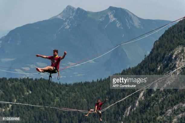 Highliners sit on a slackline during the European 'Marmotte Highline Project' meeting on July 7 2017 in LansenVercors near Grenoble eastern France /...