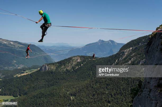 Highliners walk on a slackline during the European 'Marmotte Highline Project' meeting on July 7 2017 in LansenVercors near Grenoble eastern France /...