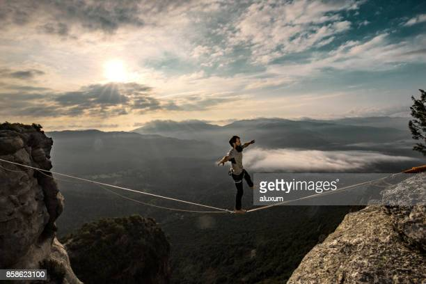 Highlining in the mountains at sunrise