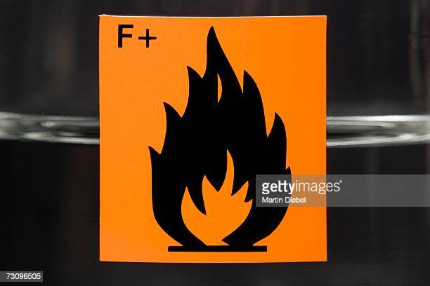 ?highly flammable? label on glass flask containing liquid - flammable stock photos and pictures