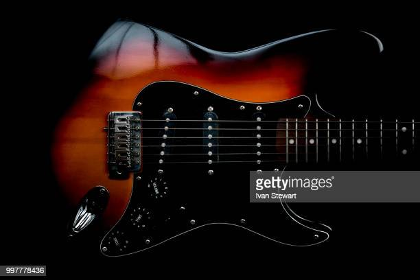 highly strung - electric guitar stock pictures, royalty-free photos & images