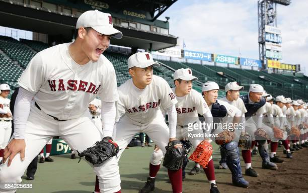 Highly touted Waseda Jitsugyo high school slugger Kotaro Kiyomiya and his teammates line up before starting fielding practice at Koshien Stadium in...