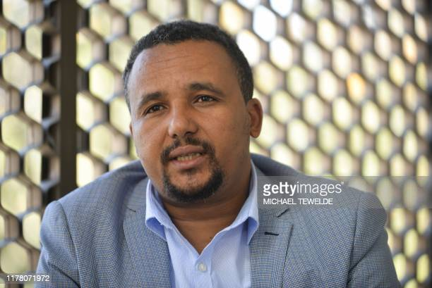 High-profile Ethiopian activist, Jawar Mohammed is photographed during an interview, in Addis Ababa on October 25, 2019. - A high-profile Ethiopian...