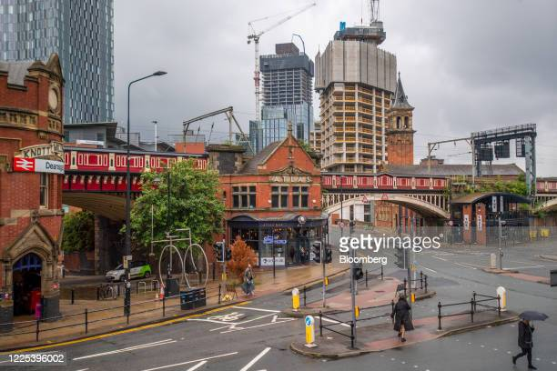 High-rise apartment block construction site, operated by Renaker Build Ltd., stands in view of Deansgate railway station in central Manchester, U.K.,...