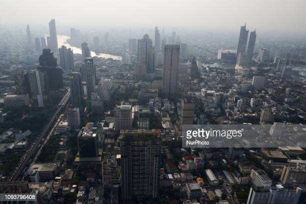 Highrise buildings and the Chao Phraya river is seen from the King Power Mahanakhon skyscraper Bangkok's highest observation deck in Bangkok Thailand...