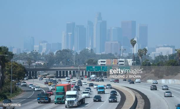 Highrise buildings in downtown Los Angeles, California are seen on on a hazy morning on September 21, 2018. - Eighty-seven days of smog this summer...