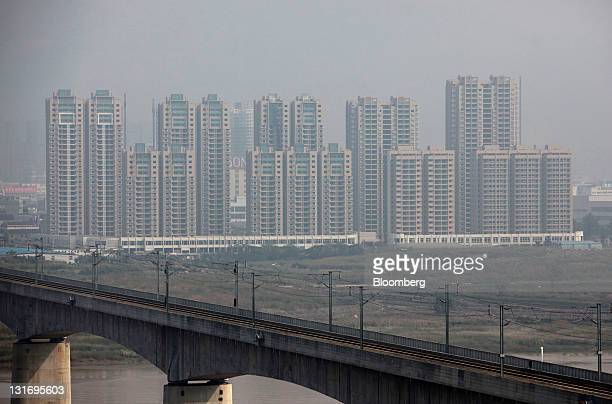 Highrise buildings stand in Wenzhou Zhejiang Province China on Monday Oct 24 2011 Wenzhou a city of 9 million whose private enterprises range from...