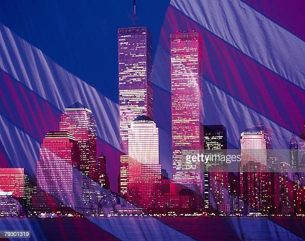 High-rise buildings with American flag at the night in New York City, NY, USA, CG, composition, long exposure