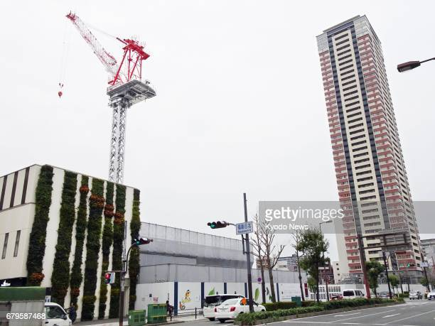 A highrise condominium is under construction near JR Osaka Station in Osaka western Japan on April 5 2017 ==Kyodo