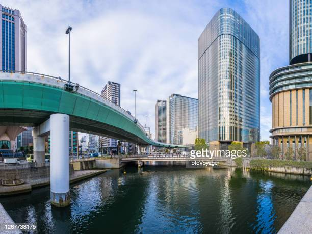 highrise highways skyscraper streets over kyu-yodo river panorama osaka japan - international landmark stock pictures, royalty-free photos & images